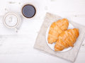Two Croissants With Coffee On The White Table Royalty Free Stock Image - 39809306