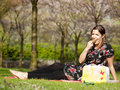 Beautiful Girl Eating A Strawberry During A Picnic Stock Photography - 39809532