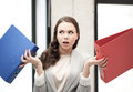 Unsure Thinking Or Wondering Woman With Folder Royalty Free Stock Image - 39810636