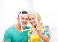 Smiling Couple With House From Measuring Tape Royalty Free Stock Images - 39811539