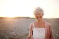 Cheerful Old Woman Standing On The Beach Stock Images - 39817994
