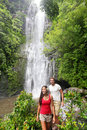 Hawaii Tourists Hiking By Waterfall Stock Photography - 39851112
