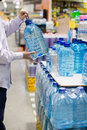 Choosing, Selecting Or Buying A Bottle Of Mineral Drinking Or Distilling Water At The Shopping Store Focus On Hands Stock Photography - 39859352