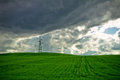 Storm Clouds And Electric Pylon In Field Of Wheat Royalty Free Stock Photos - 39873148