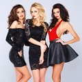 Three Sexy Elegant Women In Black Evening Wear Royalty Free Stock Images - 39878779