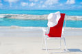 Beach Chair With White Hat By The Ocean Royalty Free Stock Photography - 39881037