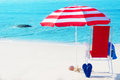 Beach Umbrella And Chair By The Ocean Royalty Free Stock Images - 39881039