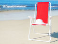 Beach Chair With White Hat By The Ocean Royalty Free Stock Images - 39881069