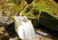 Pure Fresh Water Waterfall Running Over Mossy Rocks In The Forest Stock Photography - 39896572