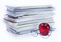 Magazine And Book Stack With Glasses And Apple Stock Image - 39914661