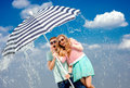 Shocked Couple Under The Umbrella Because Of The Stormy Weather Stock Images - 39948494