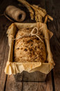 Rustic Bread In Baking Tin And Wheat On Vintage Wood Table Royalty Free Stock Photos - 39987408