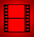 35mm Movie Film In Red Light Royalty Free Stock Photo - 4004545