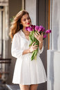 Cute Girl In White Dress And A  Beautiful Bouquet Of Tulips. Royalty Free Stock Photo - 40004435