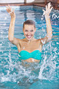 Woman In Swimming Pool Splashing Royalty Free Stock Photo - 40006545