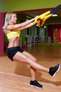Beautiful Young Woman Doing TRX Exercises Stock Images - 40036404