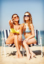 Girls With Drinks On The Beach Chairs Royalty Free Stock Image - 40039896