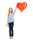 Girl Drawing Big Red Heart In The Air Royalty Free Stock Photography - 40041357