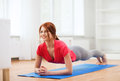 Smiling Redhead Teenage Girl Doing Plank At Home Stock Photography - 40042242