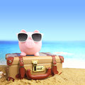 Suitcase With Piggy Bank Royalty Free Stock Image - 40049516