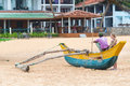 Tourist Talking With Local Man Sitting On Traditional Sri Lankan Fishing Boat Stock Photography - 40061112