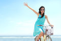 Woman Having Fun Riding Bicycle At The Beach Stock Photos - 40094463