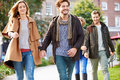 Group Of Friends Walking Through City Park Together Royalty Free Stock Image - 40096316