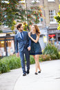Young Business Couple Walking Through City Park Together Stock Photos - 40097003