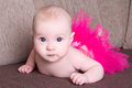 Funny Beautiful Baby Girl Lying On The Sofa Stock Images - 40110564
