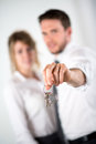 Close-up Picture Of Cheerful Young Realtor Couple Holding House Keys Stock Photography - 40133902