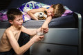 Boy Trying To Make His Brother Wet The Bed Royalty Free Stock Image - 40149146