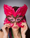 Attractive Brunette Woman Gypsy Costume Feathered Face Mask Stock Image - 40150851