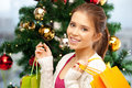 Happy Woman With Shopping Bags And Christmas Tree Royalty Free Stock Photos - 40189508