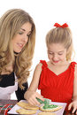 Beautiful Mother And Daughter With Cookies Stock Photos - 4025443