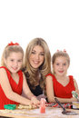 Happy Mom With Twin Daughters Decorating Cookies Royalty Free Stock Photos - 4025468