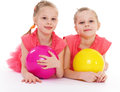 Two Charming Sisters Love To Play Ball. Stock Photo - 40215630