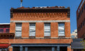 Old Red Brick Building With Shaded Windows Stock Images - 40223694