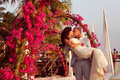 Bride And Groom Embracing Near Arch Of Flowers In Maldives Stock Photo - 40223810