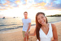 Happy Couple On Beach Holding Hands At Sunset Stock Images - 40248624