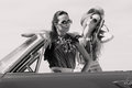 Beautiful Ladies With Sun Glasses Posing In A Vintage Car In A Sunny Day Spring Summer Royalty Free Stock Images - 40257779