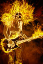 Young Woman With Guitar In Fire Flames Royalty Free Stock Images - 40282449
