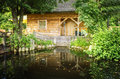 Timber House And Garden Pond Stock Photo - 40356430