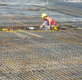 Building Worker Lays Reinforcement Royalty Free Stock Photography - 40361847