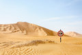 Road Sign Among Sand Dunes In Desert (Oman) Royalty Free Stock Image - 40410796