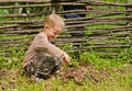 Little Boy Starting A Fire Outdoors Royalty Free Stock Image - 40416386