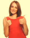 Happy Young Woman Girl Shows Positive Sign Thumbs Yes, Orange Dr Stock Photos - 40416673