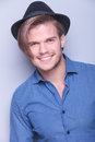 Happy Young Man Wearing Hat Smiles Royalty Free Stock Photography - 40433077