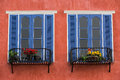 Twin Decorative Blue Window On An Old Red  Stucco Wall Stock Image - 40438911