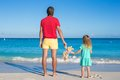 Dad With Little Baby Holding A Plush Toy On Exotic Beach Stock Images - 40447444
