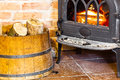 Fireplace With Fire Flame And Firewood In Barrel Interior. Heating. Royalty Free Stock Photography - 40451227
